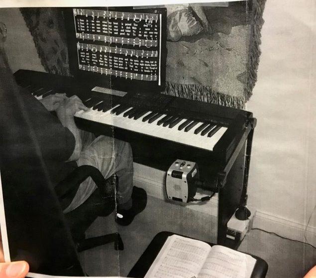 Acrobat Long Arm reading sheet music