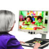 Woman viewing enlarged picture with Merlin Ultra