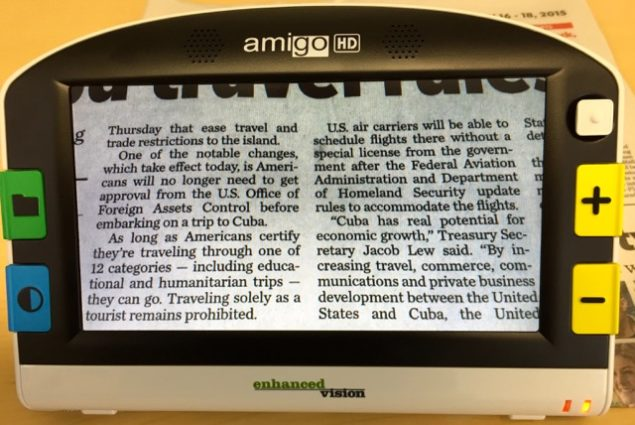 """This photo is of the *New Amigo HD, showing the same exact Newspaper column as the previous newspaper column picture on the """"old"""" Amigo. Both are displaying the text at the minimum size level and widest field of view. This NEW Amigo now has 4"""" inches of width, more than double the previous model of 1.5""""."""