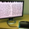 Much more comfort when viewing on a larger HD monitor. This photo is Close-Up of the *New Amigo HD, displaying 2 Newspaper Columns, sending the Amigo HD image to a HD Monitor. Same width, but the font is much bigger!