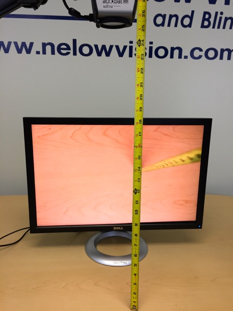"""This is a photo of the Acrobat Long Arm HD Ultra with a ruler, showing a very high 25"""" inch working distance, allowing for larger boxes, and being able to more easily see nutritional information."""