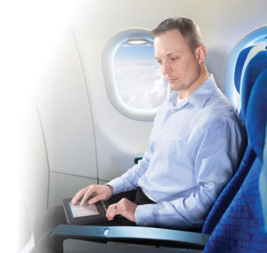 Man using BrailleNote Touch on Plane