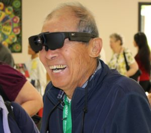 Man smiles when he discovers he can see again with NuEyes Smartglasses