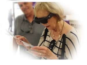Woman Reads with NuEyes featuring ODG Smartglasses