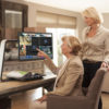 Photo of Optelec Clearview C Plus Speech on Kitchen Island with two women users