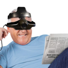 Jordy New Head Strap on a man reading a newspaper