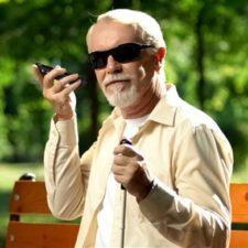 Victor Reader Trek - Blind person listening to instructions.
