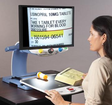 TOPAZ OCR Desktop Video Magnifier With Speech Reading medicine bottle