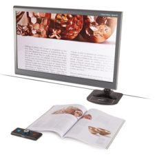 ClearView C Full HD Speech Flex With 24 Monitor reading a magazine