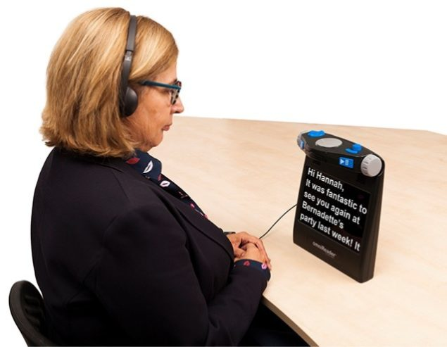 omniReader lady listening with headphones