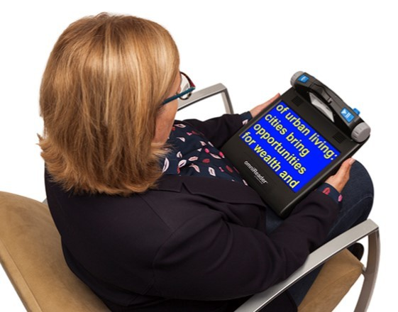 omniReader lady sitting in chair with omniReader on lap
