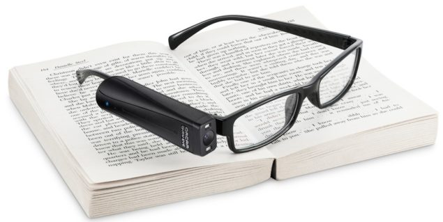 OrCam My Eye PRO on tope of a book