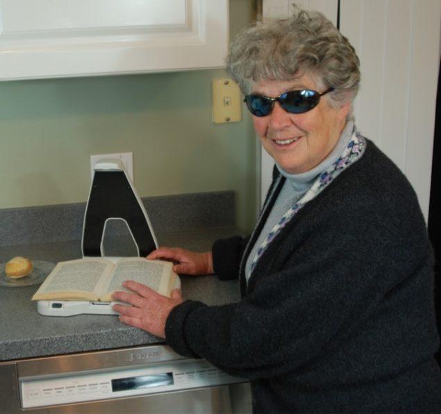 LyriQ Assistive Reader in the kitchen reading a recipe