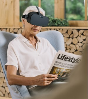 Person reading newspaper wearing Vision Buddy V2